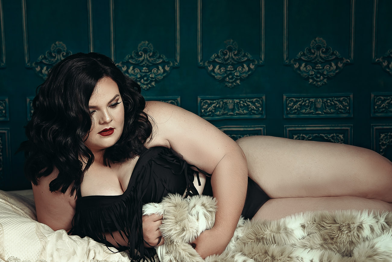"Beautiful ""Plus"" Size Woman posing with fur in her dream boudoir session"
